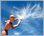 posing figure with arms reaching to clouds